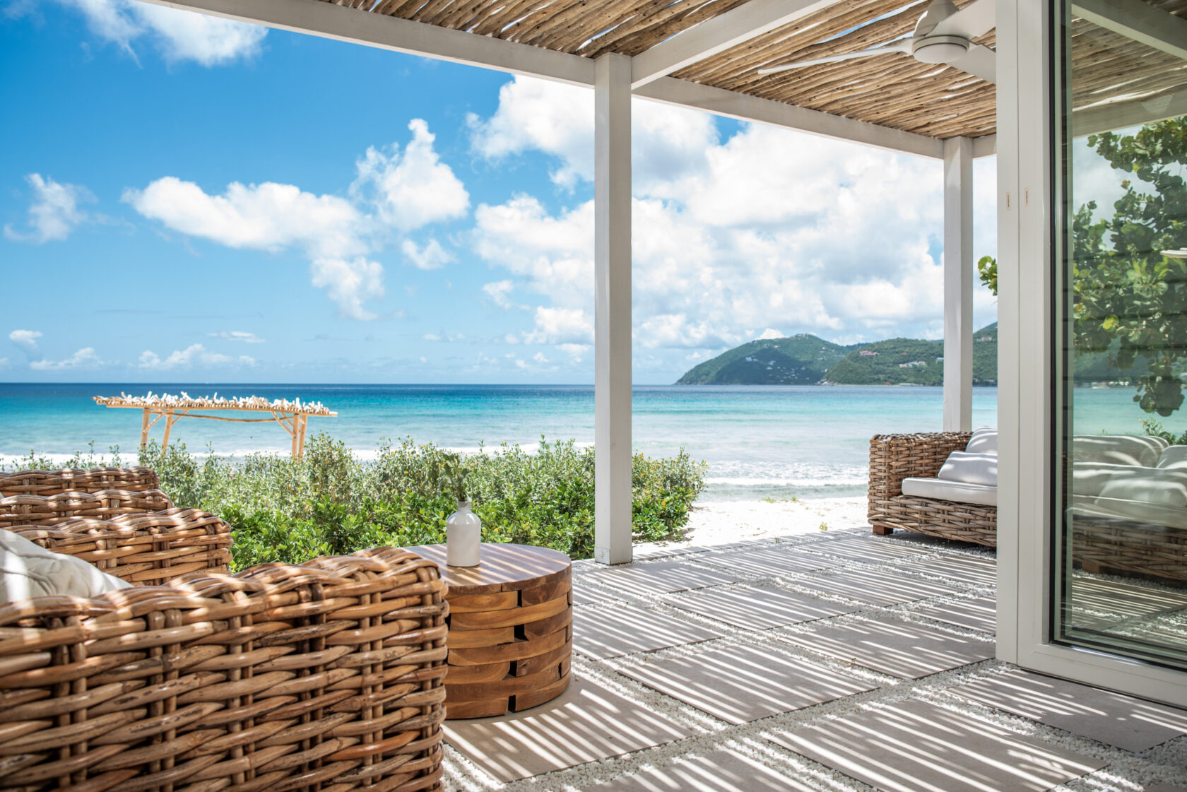 Beachside covered porch with views of the distant mountains
