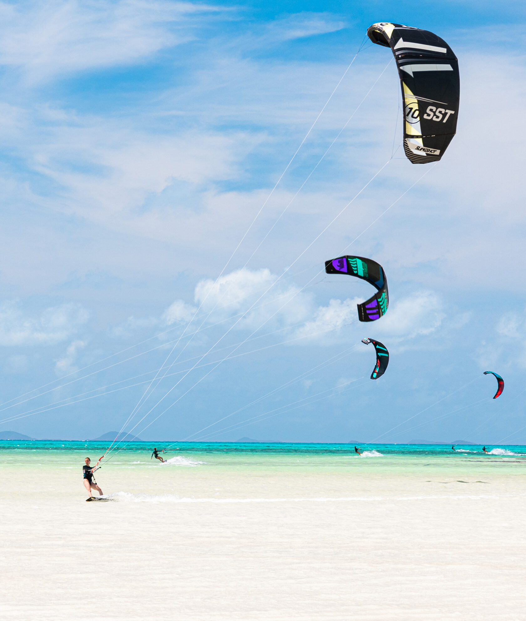 Kite surfers by the shore